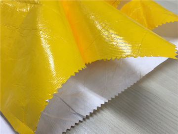Cina 0.15mm Dupont Paper Coated Garment Leather Fabric Shining Yellow Color Untuk Fashion Coat pabrik